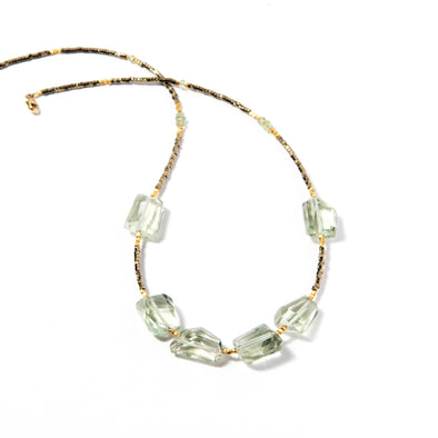 Bliss is a delicate necklace using soft green and hematite stones. This airy necklace uses faceted green amethyst and green sapphire stones. Like all SASKIA jewelry, this beaded necklace is handmade in our Brooklyn studio using materials from around the world.