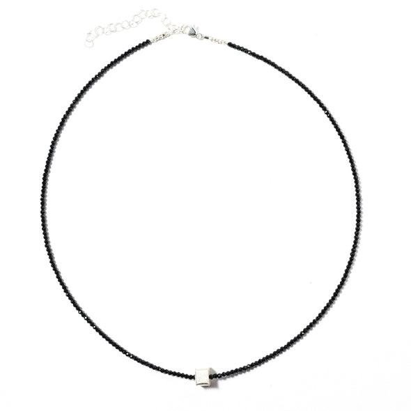 The Cubed necklace by SASKIA is a stunning combination of black spinel with a single cube of sterling silver. It's a simple, dainty, short black and silver necklace perfect for layering. Like all SASKIA jewelry, the Cubed necklace is handmade in our Brooklyn studio using materials from around the world.