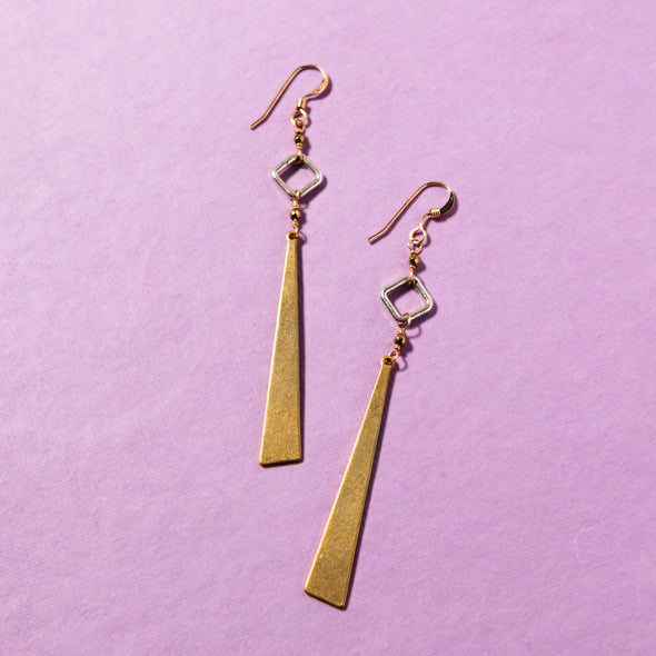 The Pyrite Cutout earrings are dangly, brass earrings. These fun necklace are made of brass, sterling silver and sparkling pyrite gemstones. Like all SASKIA jewelry, these unique earrings is handmade in our Brooklyn studio using materials from around the world.