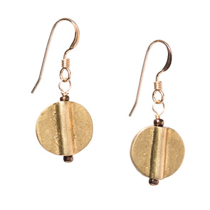These lightweight and simple short circular dangle earrings come in gold and silver to match whatever your style is. Like all SASKIA jewelry the Discus earrings are handmade in our Brooklyn studio using materials from around the world.