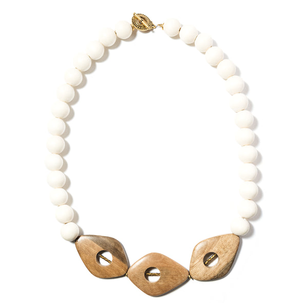 Dune is a chunky necklace made of white and earthy wood. This statement necklace is beaded with large yet light beads. Like all SASKIA jewelry, this beaded necklace is handmade in our Brooklyn studio using materials from around the world.