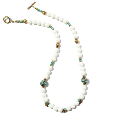 The bright, matte white jade in our Elise necklace is uniquely balanced with mosaic turquoise beads from Tibet and brass accents from India. This beaded turquoise and jade necklace is simple and elegant and makes for a great gift. Like all SASKIA jewelry, the Elise necklace is handmade in our Brooklyn studio using materials from around the world.