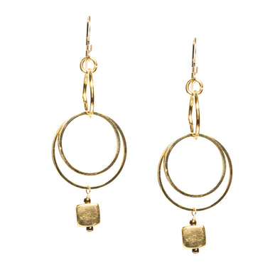 Our Funky Hoops are long dangle gold earrings. Made of three hoops and an extra dangle these earrings are perfect for every day wear and match almost anything. Like all SASKIA jewelry, the Funky Hoop earrings are handmade in our Brooklyn studio using materials from around the world.