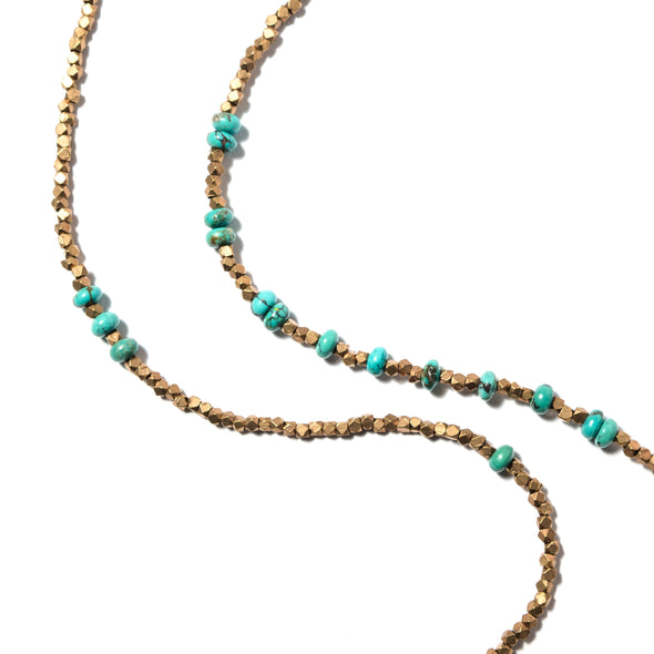 The Funky PK is a long turquoise and brass necklace that can be wrapped or worn full length or as a bracelet. This boho beaded necklace is a great layering piece. Like all SASKIA jewelry, the Funky PK necklace is handmade in our Brooklyn studio using materials from around the world.