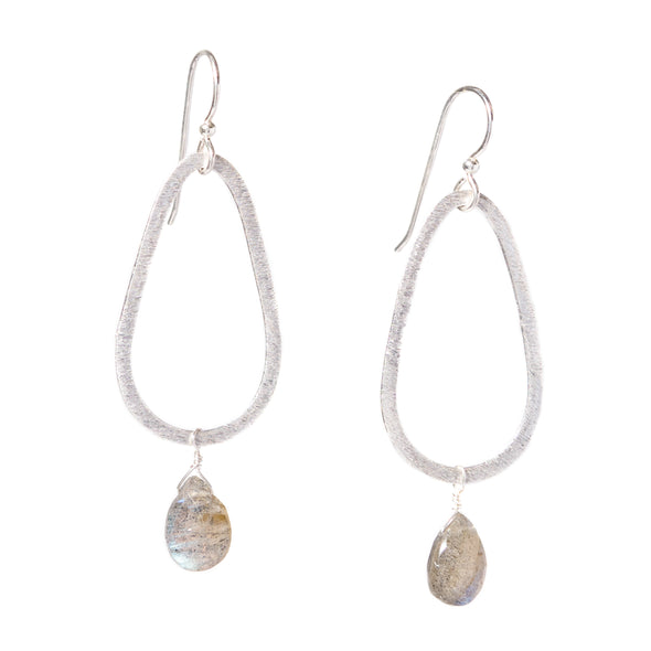 Hand-cut gemstones from Rajasthan, India set on silver vermeil teardrops. Our Silver Teardrop Gemstone Earrings come in a variety of gemstone colors to suit any outfit or style. These silver dangle earrings are a great every day piece. Like all SASKIA jewelry, the Silver Teardrop Gemstone Earrings are handmade in our Brooklyn studio using materials from around the world.