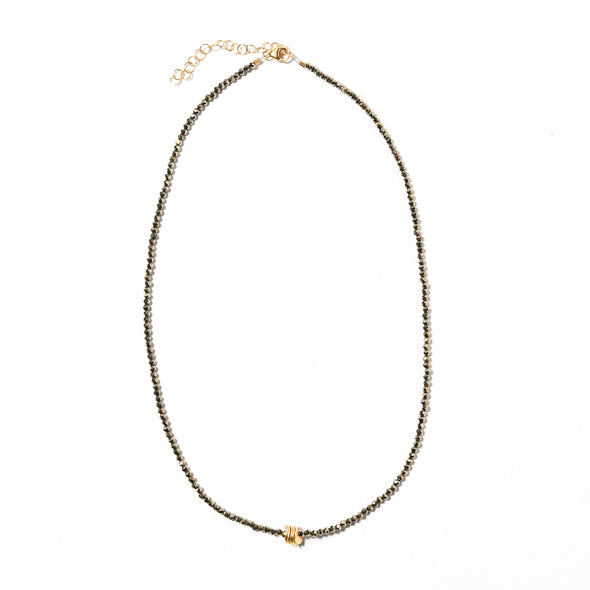 The Gia necklace by SASKIA is a stunning combination of pyrite with a single gold vermeil pendant. It's a simple, delicate, short, beaded necklace perfect for layering. Like all SASKIA jewelry, the Gia necklace is handmade in our Brooklyn studio using materials from around the world.