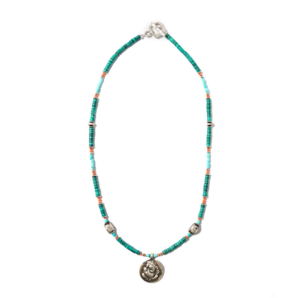 The vintage Indian silver accents and Ganesh pendant in this beach themed necklace take center stage. The reconstituted minerals in this piece are bold and yet boho in their green, turquoise and orange tones evoking the beach town of western Indian. Like all SASKIA jewelry, this beaded necklace is handmade in our Brooklyn studio using materials from around the world.