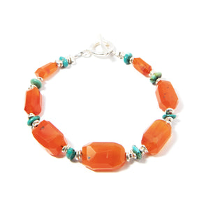 This limited bracelet is an unexpected combination of materials recycled from previous designs. Unusually-shaped deep carnelian plays off mismatched turquoise and silver beads for a happy and eclectic design. 8.5""