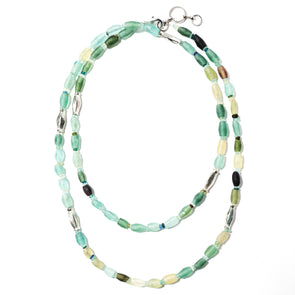 Lagoon is a long glass necklace featuring long tubes of blue and green 900 year old Roman glass. This boho beaded necklace is unique and like all SASKIA jewelry is handmade in our Brooklyn studio using materials from around the world.