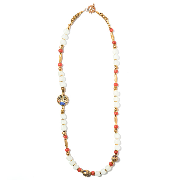 Mantra is a glass beaded necklace that features a turquoise and coral focal bead. This bold statement necklace is a great example of SASKIA's unique jewelry line. Like all of our pieces, the Mantra is a handmade necklace, made in our Brooklyn studio using materials from around the world.
