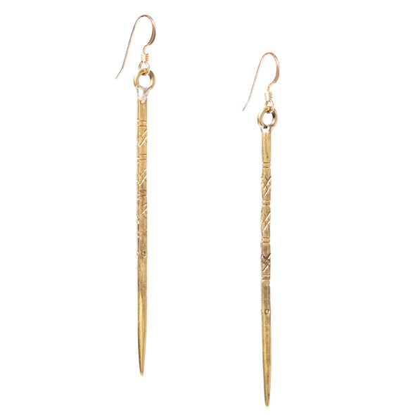 Mien are long dangle spear earrings that come in silver or gold. These modern edgy earrings have unique carvings, and their engravings are what make them so special.