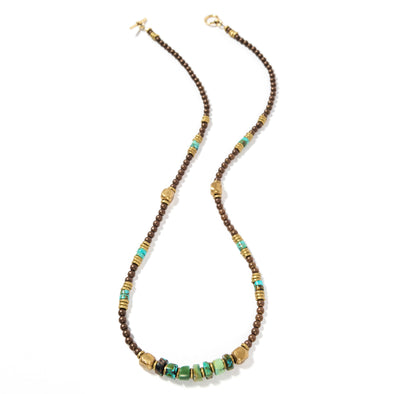 Moss is a turquoise and brass necklace that feels boho, rustic, and earthy. This beaded necklace, like all SASKIA jewelry, is handmade in our Brooklyn studio using materials from around the world.