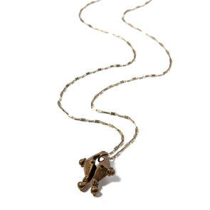 The Navarro Chain is a long chain necklace with a unique unusual pendant designed by David Navarro. This necklace works great on its own or layered with other necklaces.