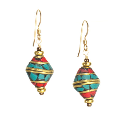 Our Nepal Mosaic Earrings are short dangle earrings with a Nepalese bead with a combination of turquoise and lapis or coral. These colorful unique earrings have a boho feel and are versatile enough for everyday wear. Like all SASKIA jewelry, these earrings are handmade in our Brooklyn studio using materials from around the world.