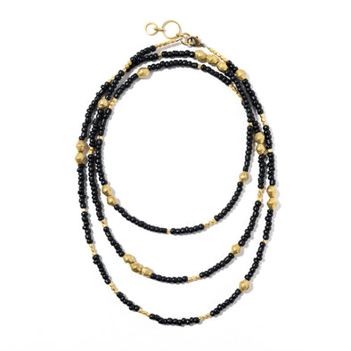 Made from beautiful matte Indonesian glass and brass from India and Ethiopia, this versatile piece can be worn wrapped up to three times as a necklace or as a funky bracelet. As with all SASKIA jewelry, this beaded necklace is handmade in our Brooklyn studio using materials from around the world.