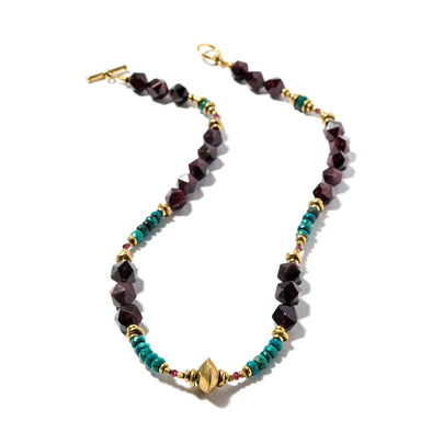 Pinot Noir is a statement necklace made of garnet, brass and chrysocolla. This unique necklace is elegant and perfect for a special occasion. Like all SAKSIA jewelry, this beaded stone necklace is handmade in our Brooklyn studio using materials from around the world.