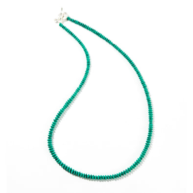 Ria is a short beaded necklace. This vibrant turquoise necklace is dainty and delicate and can be layered with other necklaces. Like all SASKIA jewelry, this handmade necklace is made in our Brooklyn studio using materials from around the world.