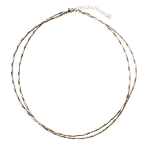 The Silver '88 is a delicate two row necklace using Thai silver beads. This two strand necklace uses a combination of smooth and texture silver beads. Like all SASKIA jewelry, this beaded necklace is handmade in our Brooklyn studio using materials from around the world.