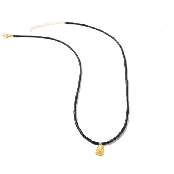 Single Ladies is a black jade necklace. This delicate beaded necklace features a gold pendant. Like all SASKIA jewelry, this funky simple necklace is handmade in our Brooklyn studio using materials from around the world.