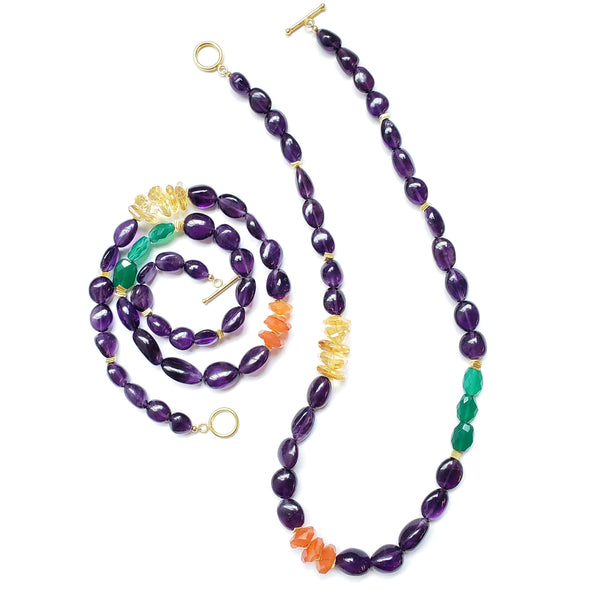 The Smithsonian is an amethyst, citrine, carnelian and green onyx necklace. This colorful bold necklace is a statement piece. Like all SASKIA jewelry, this bold chunky necklace is handmade in our Brooklyn studio using materials from around the world.