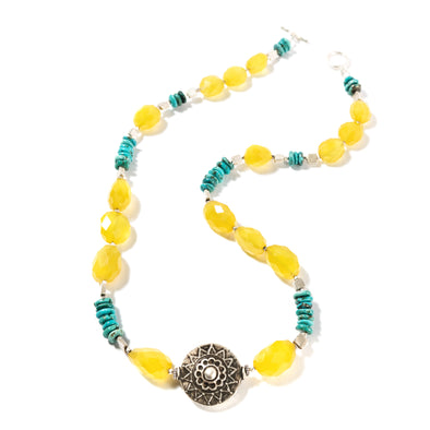Solstice is a unique statement necklace. This yellow and blue necklace is bold and boho feeling. Featuring bright chalcedony and natural turquoise, this necklace is a chunky bohemian statement. Like all SASKIA jewelry, this beaded necklace is handmade in our Brooklyn studio using materials from around the world.