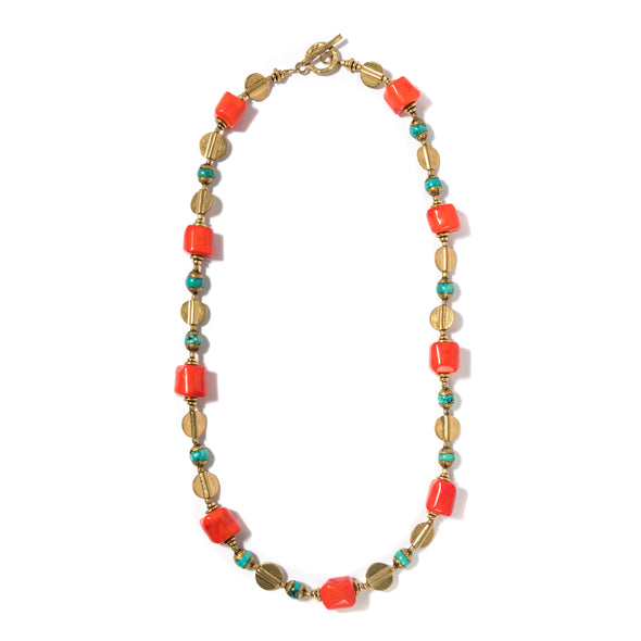 This colorful beaded necklace features turquoise and orange hued coral beads. Stolen is a chunky bold necklace that can be layered or worn by itself. This statement necklace is perfect for every day or for a special occasion. Like all SASKIA jewelry, the Stolen necklace is handmade in our Brooklyn studio using materials from around the world.