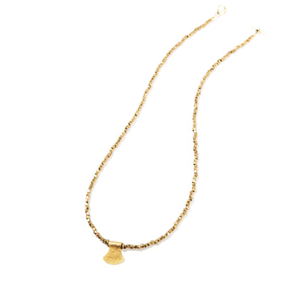 Stonehenge is a delicate brass necklace that looks great on its own or can be layered with other necklaces. This beaded simple necklace features a gold pendant. Like all SASKIA jewelry, the Stonehenge necklace is handmade in our Brooklyn studio using materials from around the world.