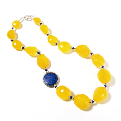 The Sunbeam is a bold necklace contrasting deep blue and yellow stones. This beautiful necklace uses faceted yellow chalcedony and a silver encased lapis lazuli. Like all SASKIA jewelry, this beaded necklace is handmade in our Brooklyn studio using materials from around the world.