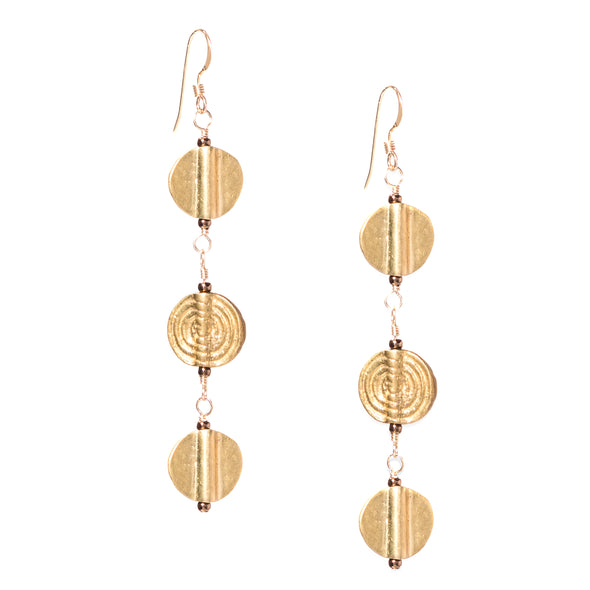 These lightweight triple circle dangle earrings come in gold and silver to match whatever your style is. Like all SASKIA jewelry the Triple Discus earrings are handmade in our Brooklyn studio using materials from around the world.
