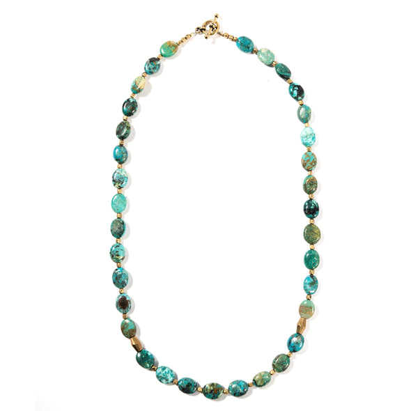 Turquoise Impression is a unique beaded necklace featuring turquoise stones. Each necklace is one of a kind since no two turquoise stones are alike. This bold statement necklace is perfect for layering with other necklaces or on its own. Like all SASKIA jewelry, this blue necklace is handmade in our Brooklyn studio using materials from around the world.