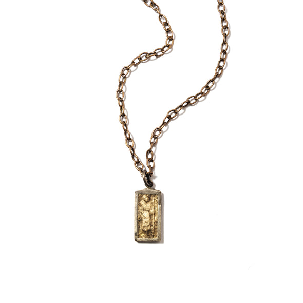 This Buddha pendant necklace is strung on chain and is a perfect layering necklace.