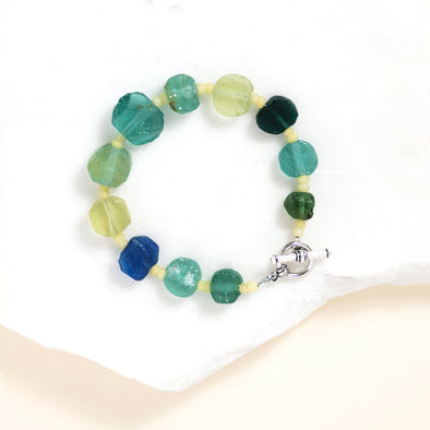 The Brook bracelet combines beads of 900-year old Roman glass in a simple but beautiful pattern. Each bracelet is unique because of the material it uses. This is a stackable bracelet you can mix and match with our other handmade SASKIA bracelets.