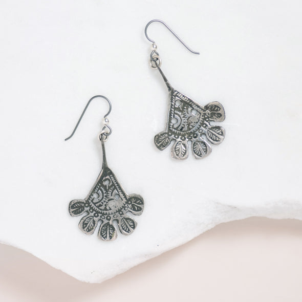 The Libyan Hamsa Earrings have a boho feel. These long dangle silver earrings are unique and hand cast in Morocco.