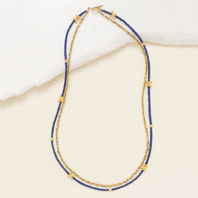 This two strand necklace is made with lapis lazuli, gold vermeil and brass. Little Lapis is a unique, boho, beaded necklace. Like all SASKIA jewelry, Little Lapis is handmade in our Brooklyn studio using materials from around the world.