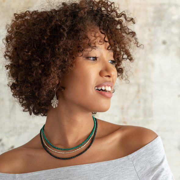 This color blocked necklace has a modern, edgy look with sections of Afghan black jade, reconstituted turquoise, and Indian white metal. Wear it long, or wrap it up to make it look like three different necklaces. The Biker Babe, like all SASKIA jewelry, is a handmade necklace made in our Brooklyn studio using materials from around the world.