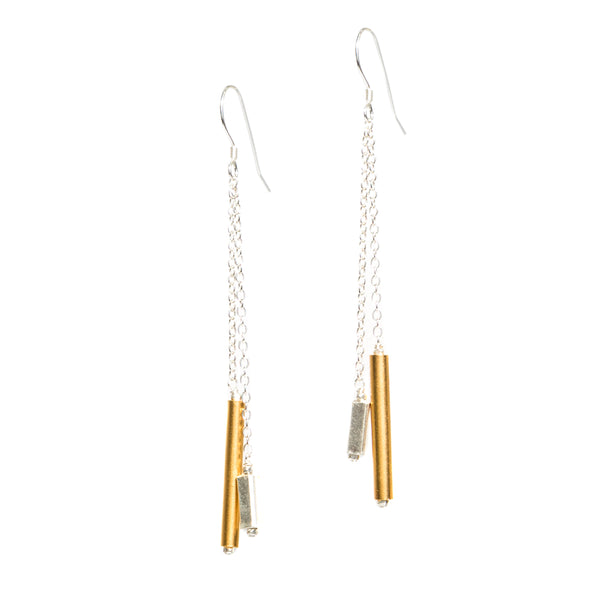 Our Windchime Earrings are long gold and silver dangle earrings. Perfect for a special occasion or every day wear. These elegant simple earrings are unique and different.