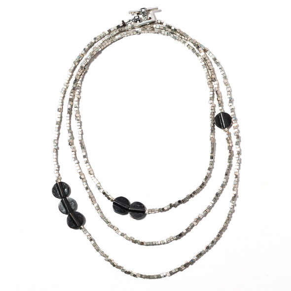 Yukiko is a long black and silver necklace. This edgy funky necklace is made of brass and silver toned metal. This bold statement necklace can be worn long, or wrapped short like a multi strand choker or even a stacked multi strand bracelet. Like all SASKIA jewelry, this unique beaded necklace is handmade in our Brooklyn studio using materials from around the world.