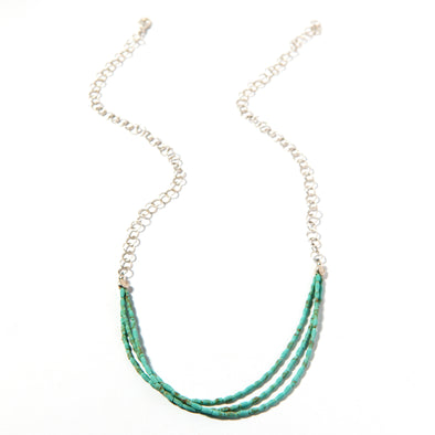 Zadran's Turquoise is a multi strand turquoise necklace with silver chain. This funky statement necklace feels delicate and light. Like all SASKIA jewelry, this beaded necklace is handmade using materials from around the world.