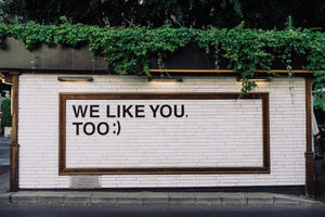 wall with writing that says 'We Like You Too'