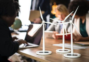 Image of small display windmills in a team meeting