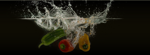 Vegetables splashing into water