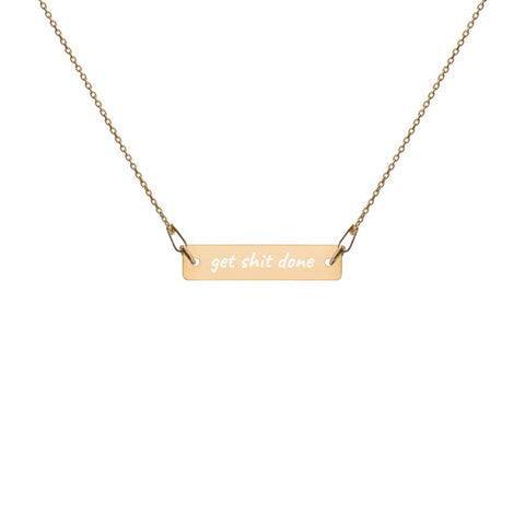 Gold bar chain necklace with engraved 'get shit done' message.