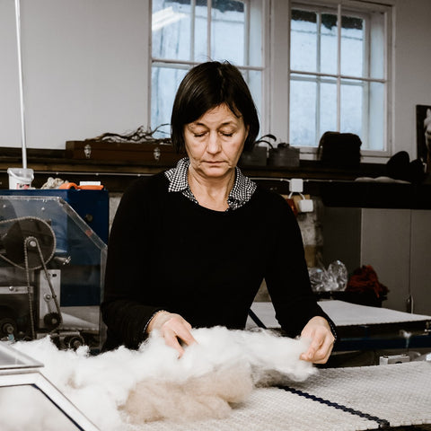 The owner of Ruukki's spinning mill sorts alpaca wool