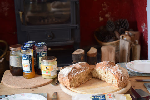 A Table Laid with Soda Bread and Jam