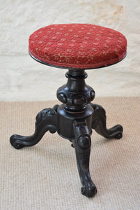 Antique red padded piano stool