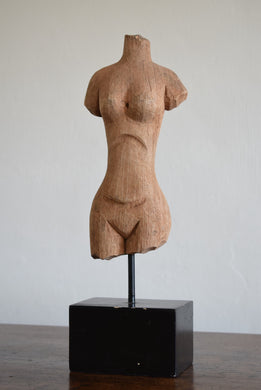 carved wooden torso