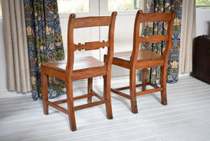 Antique pair of pitch pine chairs