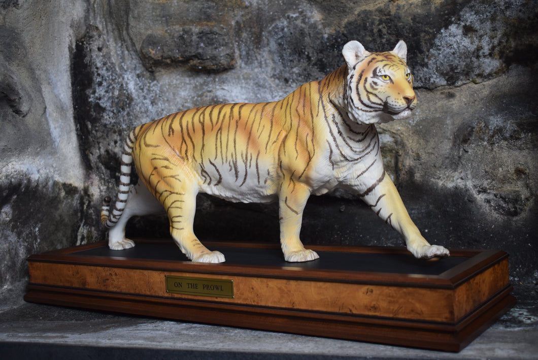 ceramic tiger stood upon wooden plinth