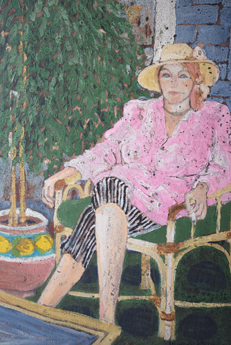 Portrait of a seated woman in Pink