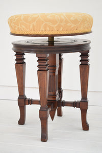 Antique revolving piano stool